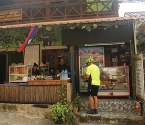 Michael buying breakfast at the bakery in Pak Beng