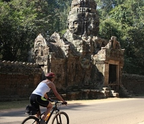 Carel passes gatehouse at Angkor complex