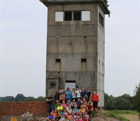 Group at corner East German watchtower
