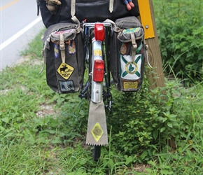 Colin's panniers are always a thing of beauty. He worked for the YHA and repairs much himself, the badges are tours we have been on