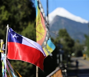 Chilean flag and Villarica Volcano