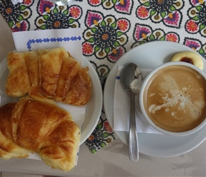Coffee and sweet croissant