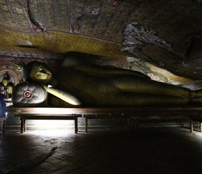Phil takes a picture of a reclining Buddha in Dambulla