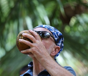 Bruce drinking coconut
