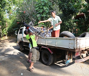Thomas helps load the bikes for their trip back to Negombo
