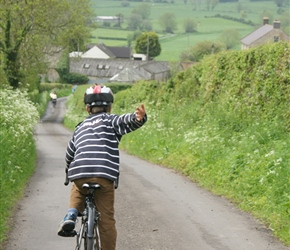 Edward  descends towards Glastonbury Tor from Wells, along Sustrans route
