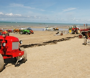 Tractors on beach, used to pull the boats in and out of the surf