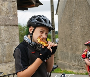 George wrestling a pain au raisin in Teutheville Bocage