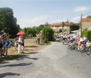 and as the peloton passes by...