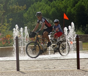 Gary and Harrison through the fountains in Pons