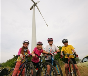 Alice, Freya, Erica and Jacob under the windmill