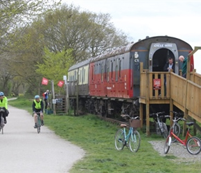 Penny and Siobhan pass the railway carriage tearoom on the Greenway